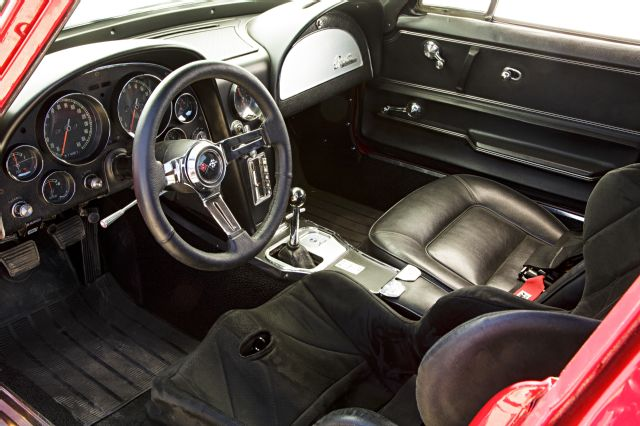 Interior shot of the C2 Corvette showing the driver's seat replaced with a racing bucket seat.
